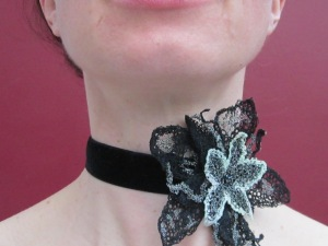 Black velvet choker embellished with freehand machine-embroidery on chiffon.